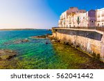coast of ortigia island at city ... | Shutterstock . vector #562041442