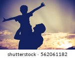 father and son playing in the... | Shutterstock . vector #562061182