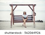 beautiful young woman sat on a... | Shutterstock . vector #562064926