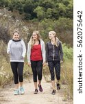 three attractive women in their ... | Shutterstock . vector #562075642