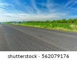 asphalt road and countryside... | Shutterstock . vector #562079176