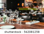 glasses  flowers  fork  knife... | Shutterstock . vector #562081258