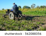Farmer On Old Handmade Tractor...