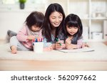 pretty happy japanese mother... | Shutterstock . vector #562097662