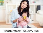 pretty happy japanese mother... | Shutterstock . vector #562097758