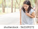 woman chest pain while jogging | Shutterstock . vector #562109272