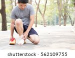 sports injury. man with pain in ... | Shutterstock . vector #562109755