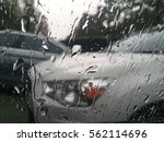 Small photo of Rain and Airdrop at glass with background of car