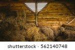 old wooden barn with haystacks | Shutterstock . vector #562140748