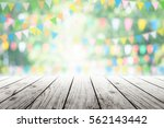 empty wooden table with party... | Shutterstock . vector #562143442
