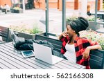 young beautiful afro black... | Shutterstock . vector #562166308