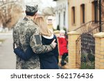 happy reunion of soldier with... | Shutterstock . vector #562176436