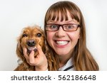 Stock photo funny smiling dog and veterinarian in veterinary clinic animal and pet veterinary care concept 562186648