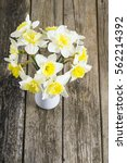 white daffodils at china vase... | Shutterstock . vector #562214392