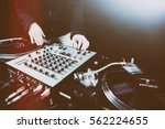 club dj playing mixing music on ... | Shutterstock . vector #562224655
