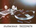 club dj playing mixing music on