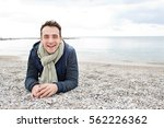 beautiful young man laying on a ... | Shutterstock . vector #562226362