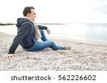 serene thoughtful smiling young ... | Shutterstock . vector #562226602