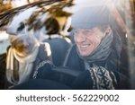 senior couple in winter clothes ... | Shutterstock . vector #562229002