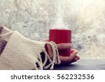 hand wrapped plaid holding a... | Shutterstock . vector #562232536