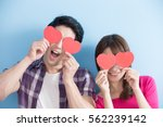 attractive young couple holding ... | Shutterstock . vector #562239142