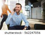 handsome businessman talking on ... | Shutterstock . vector #562247056
