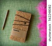 cork notebook on fabric... | Shutterstock . vector #562248082