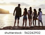 rear view of friends standing... | Shutterstock . vector #562262932