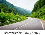 empty road in mountains. green... | Shutterstock . vector #562277872