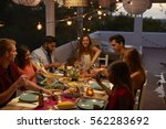 friends talking at a dinner... | Shutterstock . vector #562283692