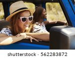 two female friends driving open ...   Shutterstock . vector #562283872
