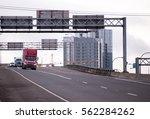 convoy of big rigs american... | Shutterstock . vector #562284262
