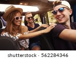 group of friends driving open... | Shutterstock . vector #562284346