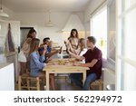 six adult friends at a casual... | Shutterstock . vector #562294972