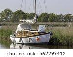 broads cruiser sailing boat... | Shutterstock . vector #562299412