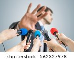many reporters are recording... | Shutterstock . vector #562327978