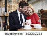 man giving to his girlfriend... | Shutterstock . vector #562332235