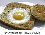 fried egg in the basket.... | Shutterstock . vector #562334326