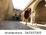 couple sightseeing old... | Shutterstock . vector #562337305