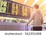 passenger looking at departures ... | Shutterstock . vector #562351408