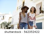 two female friends on holiday... | Shutterstock . vector #562352422