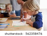 kids working at kitchen table... | Shutterstock . vector #562358476