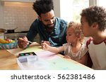 children and father painting... | Shutterstock . vector #562381486