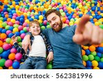 happy little boy and his father ... | Shutterstock . vector #562381996