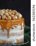 caramel party cake with popcorn ... | Shutterstock . vector #562383196