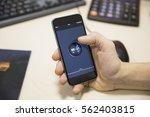 man hand holding black mobile... | Shutterstock . vector #562403815