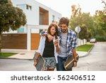 young couple having fun... | Shutterstock . vector #562406512
