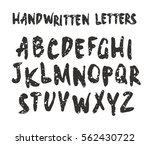 vector handwritten brush script.... | Shutterstock .eps vector #562430722
