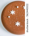 Small photo of Chocolate velour Christmas mousse cake with snowflakes