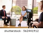 man and woman on set for a tv... | Shutterstock . vector #562441912